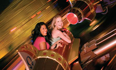 Young Women Riding Astro Orbitor