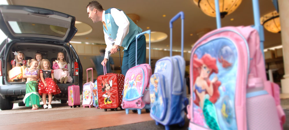 Girls Costumed as Disney Princesses Arriving at a Hotel with Their Disney Princess Rollaway Luggage