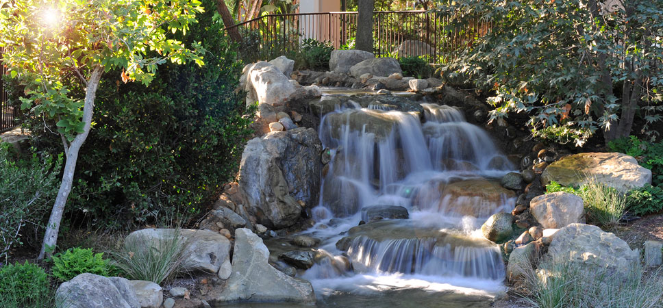 A small falls fills a landscaped area near the Frontier Tower.