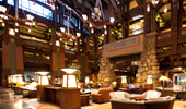 Very wide shot of the expansive lobby with fireplace and seating areas.