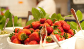 A large dish of strawberries