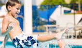 A boy splashes in the Disney's Paradise Pier Hotel pool.