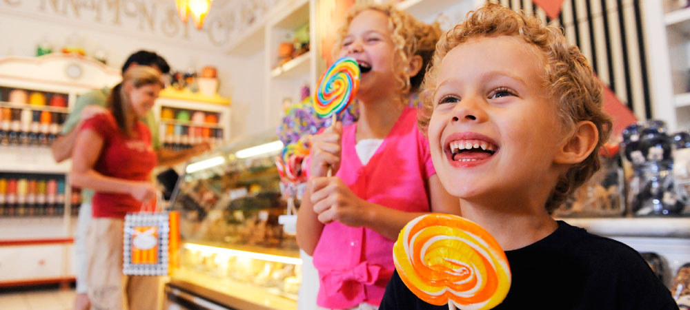 Delighted Kids with Lollipops at Marceline's Confectionery